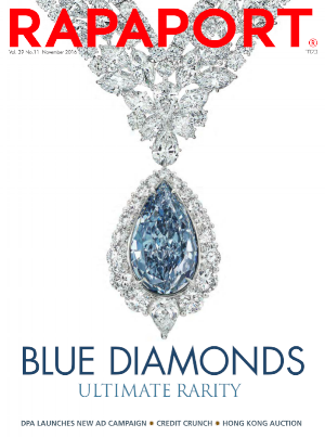 A rare Natural Intense Blue Diamond set in a white diamond necklace by Scott West by L.J. West Diamonds