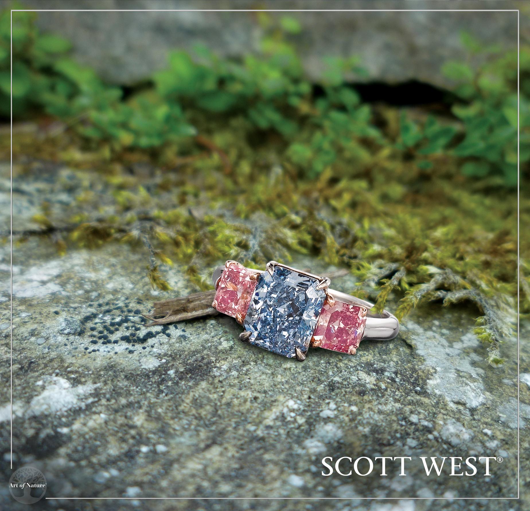 Scott West - Vivid Blue diamond with Pink diamonds    Vivid Blue Radiant, 3 ct Vivid and Intense Pink side stones, 0.78 ct & 0.68 ct     Inquire