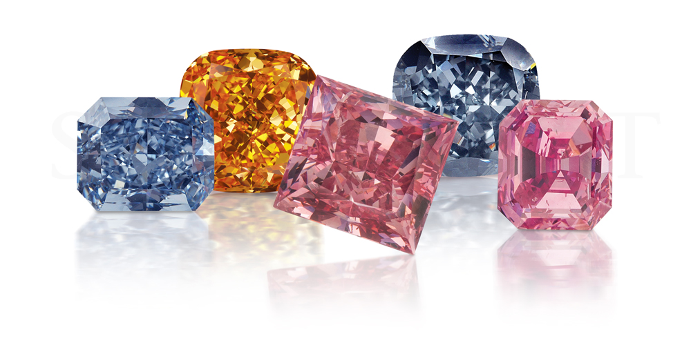 A collection of blue, orange, and pink diamonds from L.J. West Diamonds. (0.30 carats in size each)