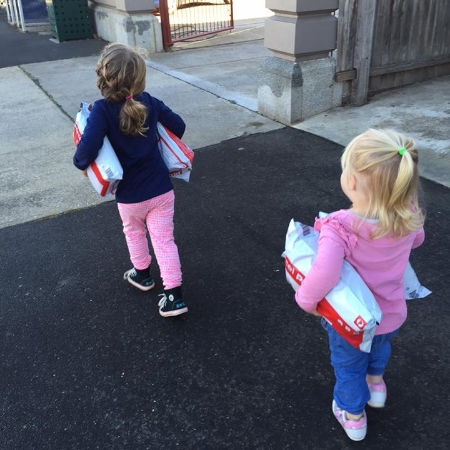 Two little girls delighted to be helping their self employed mother deliver parcels from  Fair Dinkum Dog Coats  to the post office.