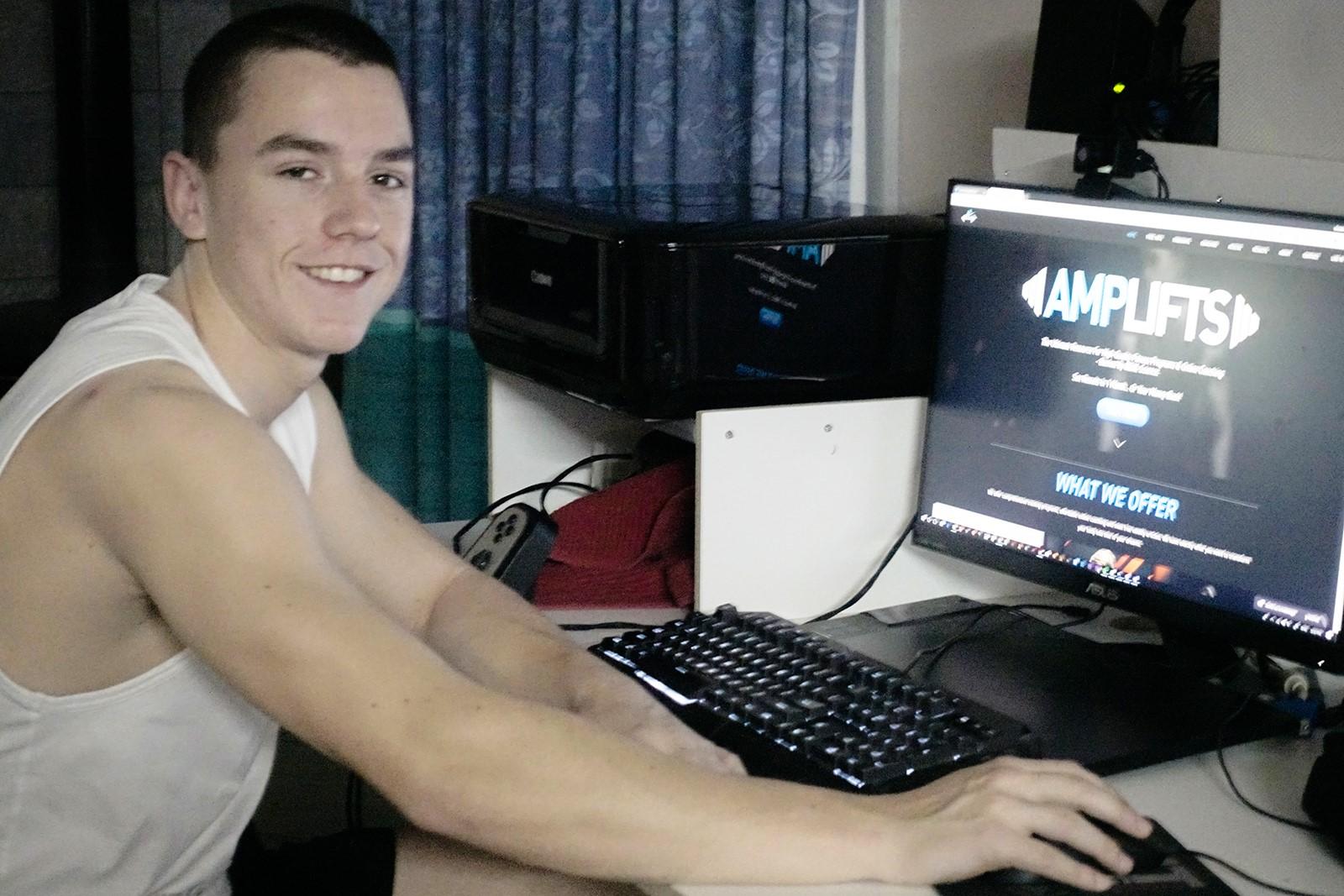 Brendan Murphy at computer.jpg