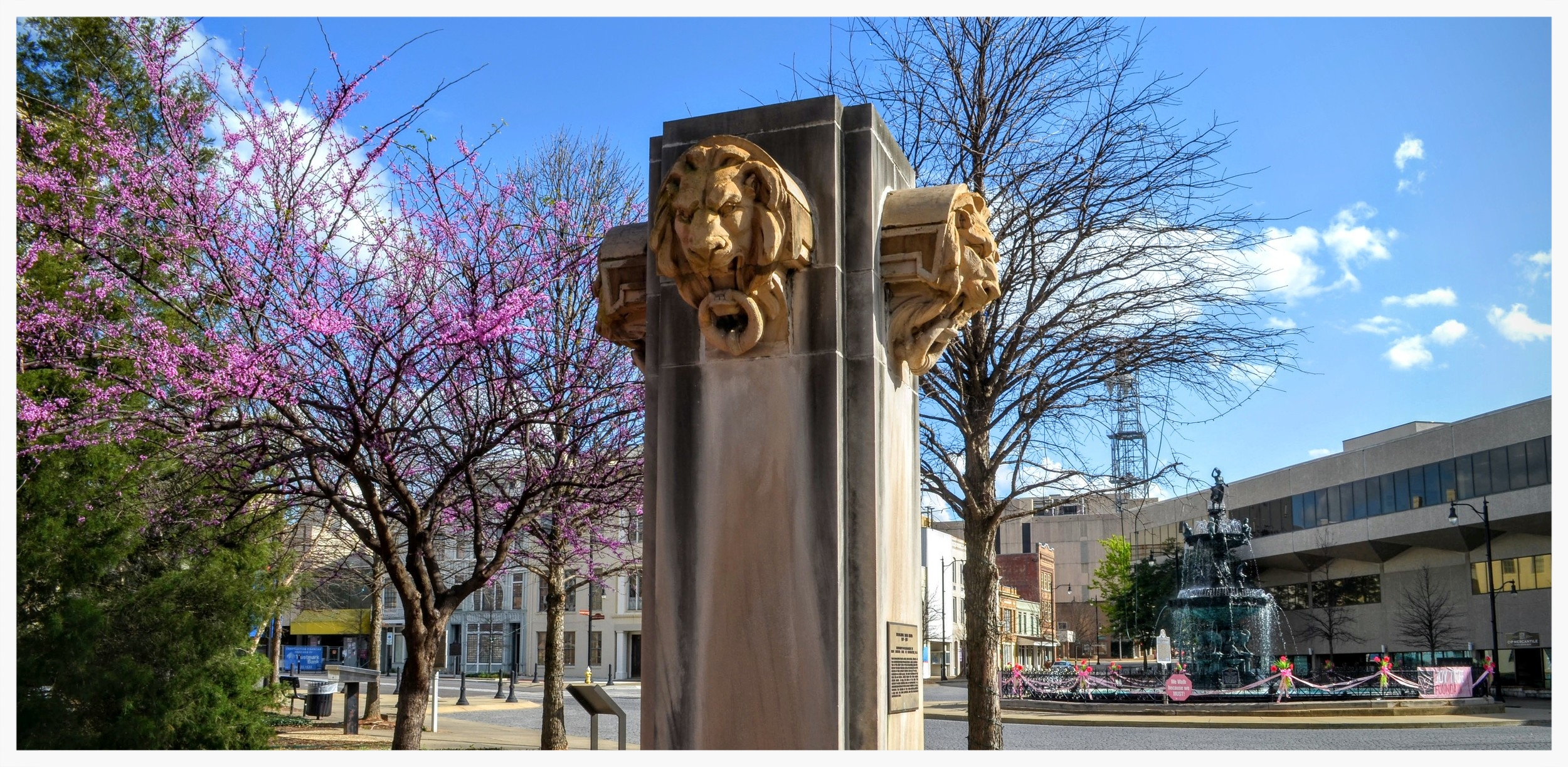 Decorative Lions Heads on their stele on the north side of Court Square, Montgomery, Alabama