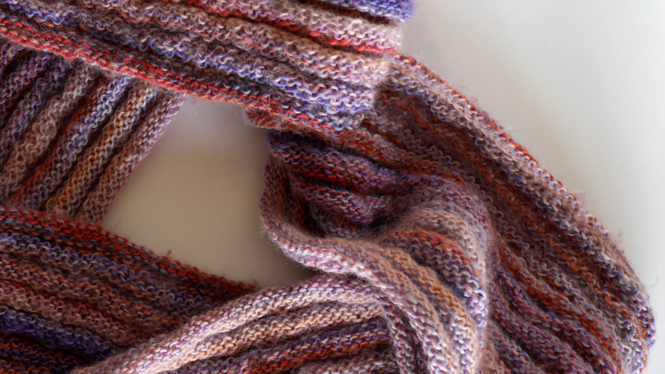 A hand knitted scarf by Talea.