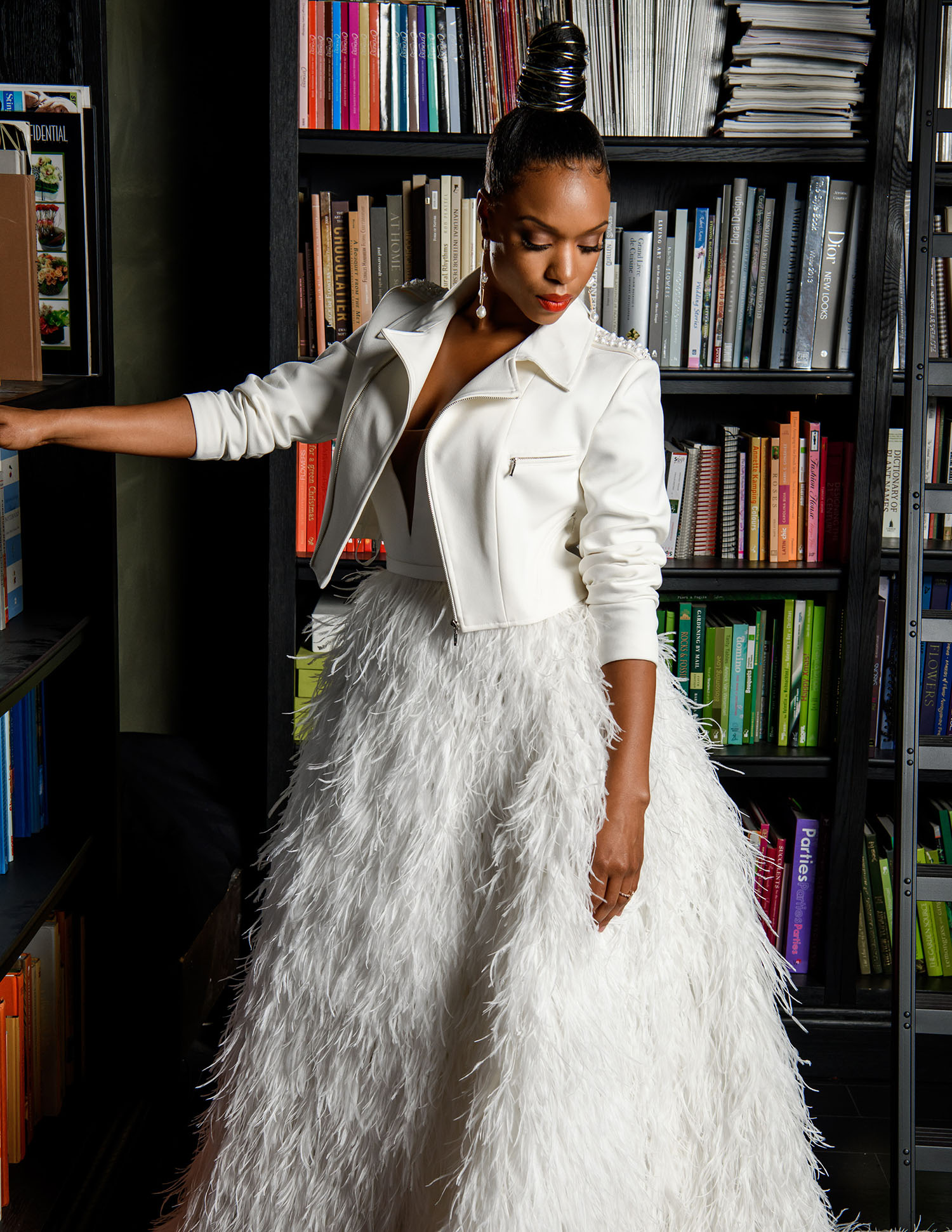 MunaLuchi Bride Winter 2019 Michelle Mitchenor Bridal Shoot - Set design by Eddie Zaratsian - white bridal motorcycle jacket and feather skirt