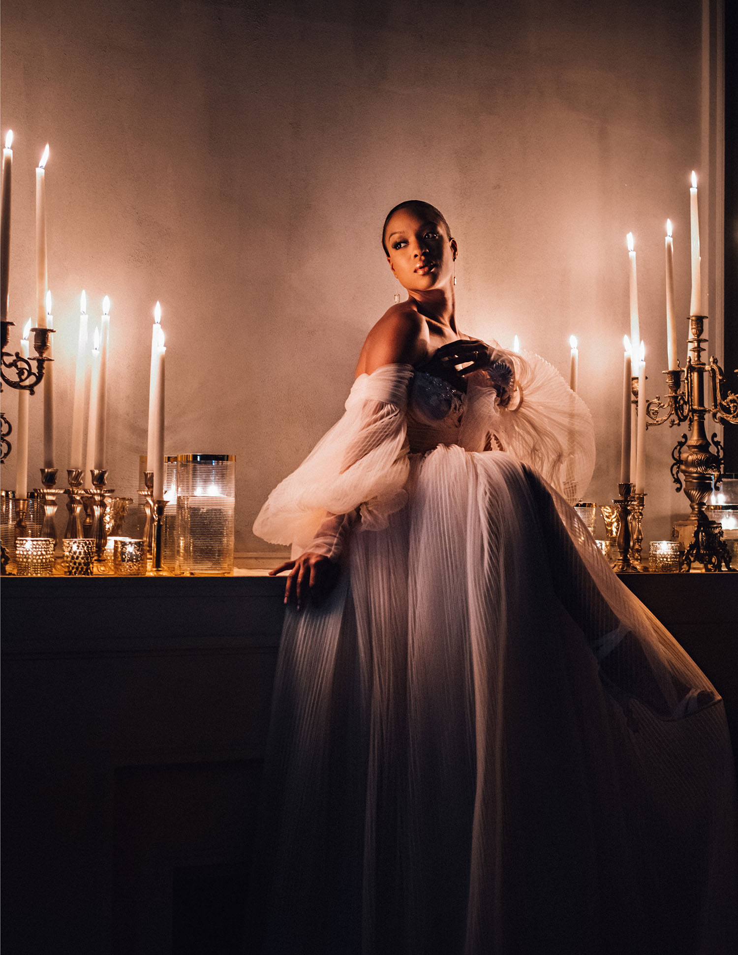 MunaLuchi Bride Winter 2019 Michelle Mitchenor Bridal Shoot - Set design by Eddie Zaratsian - romantic blush wedding gown in candle light