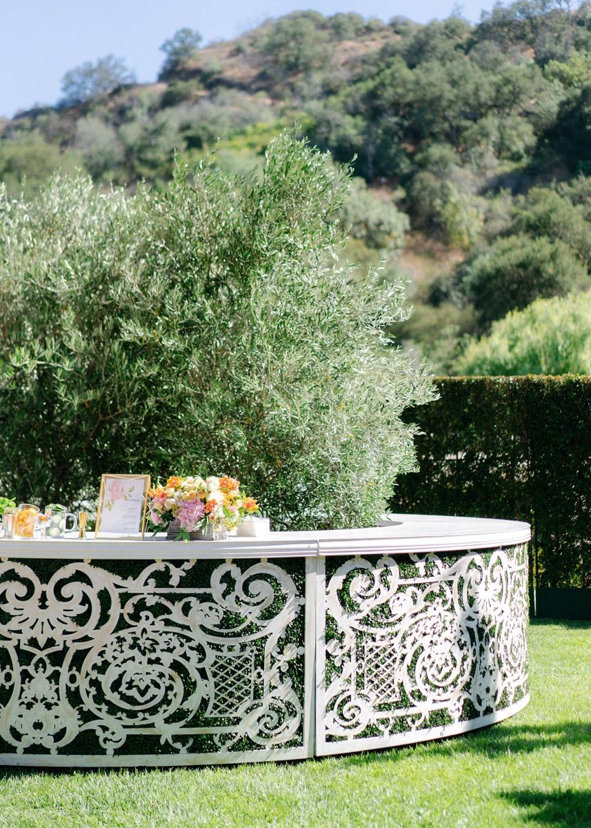 Summer garden wedding bar area - floral design by Eddie Zaratsian