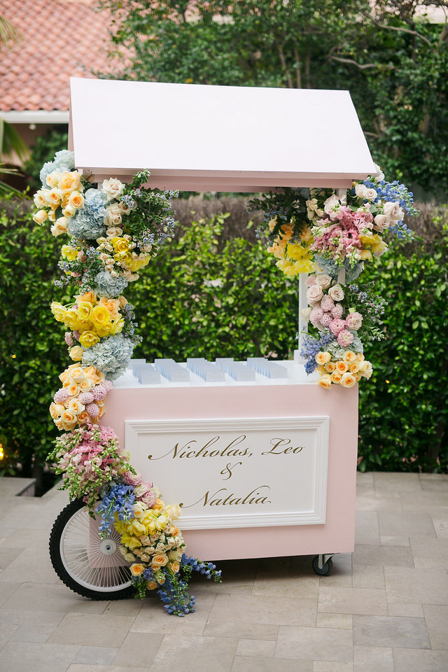 Spring butterfly themed baptism reception seating card display cart - floral design by Eddie Zaratsian