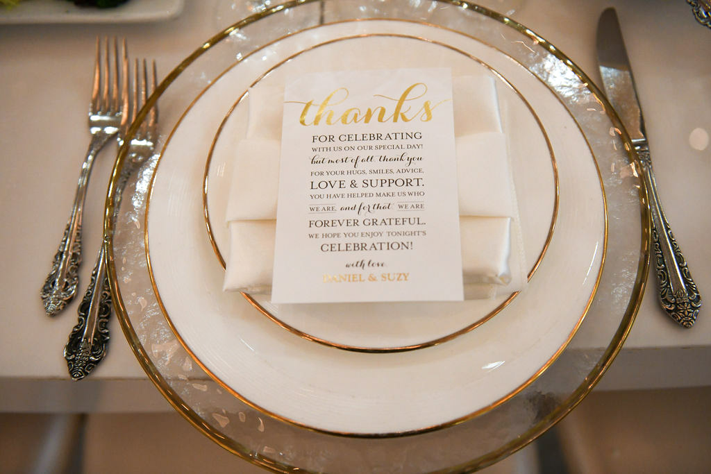 White and gold wedding place setting - design by Eddie Zaratsian
