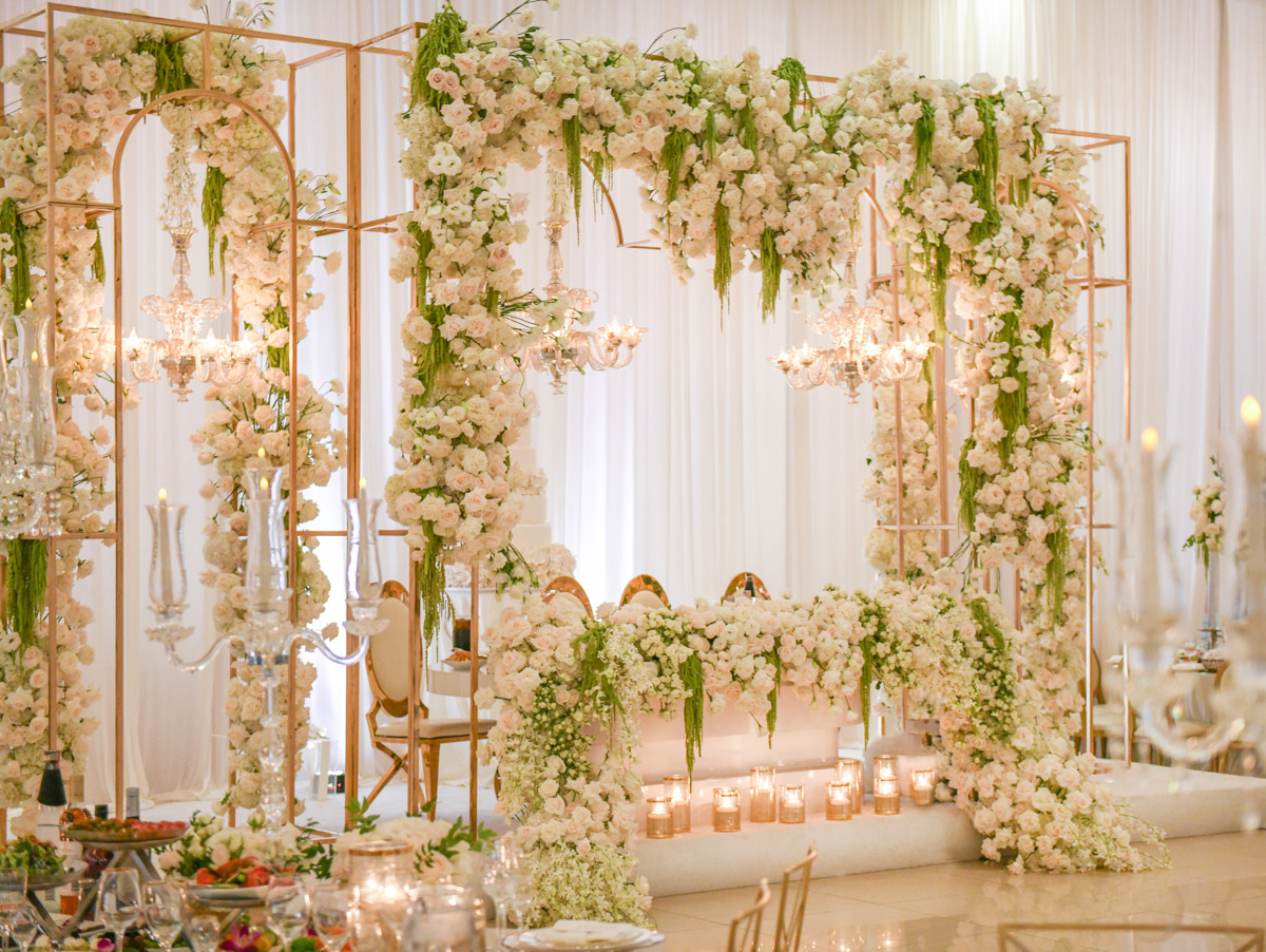 Glamorous white, gold and green wedding reception floral decor by Eddie Zaratsian
