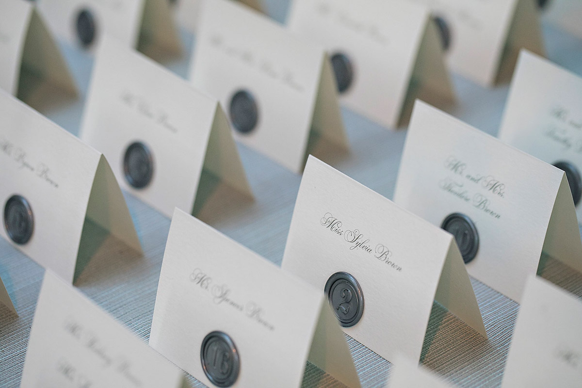 Hotel Bel-Air wedding reception place cards, florals designed by Eddie Zaratsian, Photo by Jessica Claire Photography