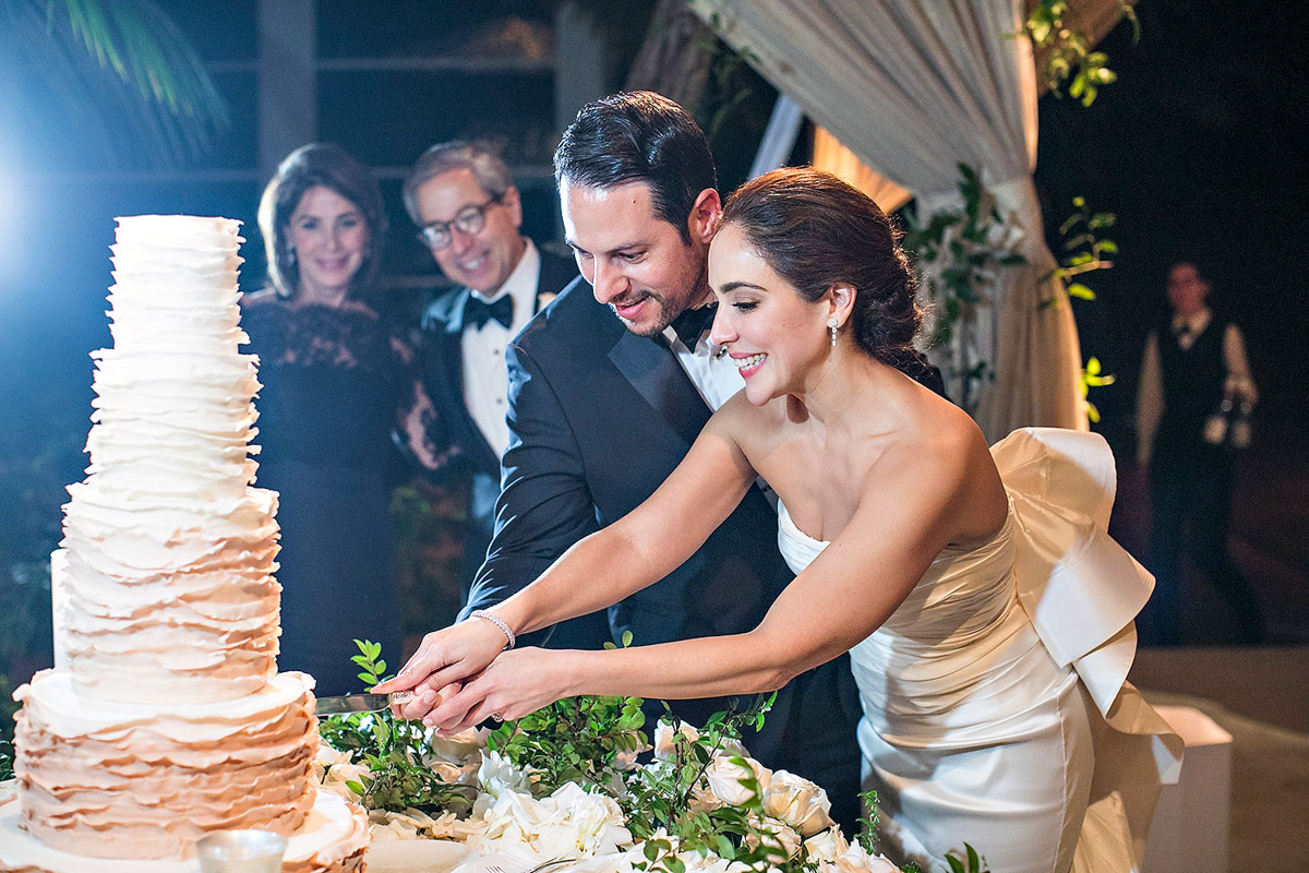 Hotel Bel-Air wedding reception cake cutting, florals designed by Eddie Zaratsian, Photo by Jessica Claire Photography