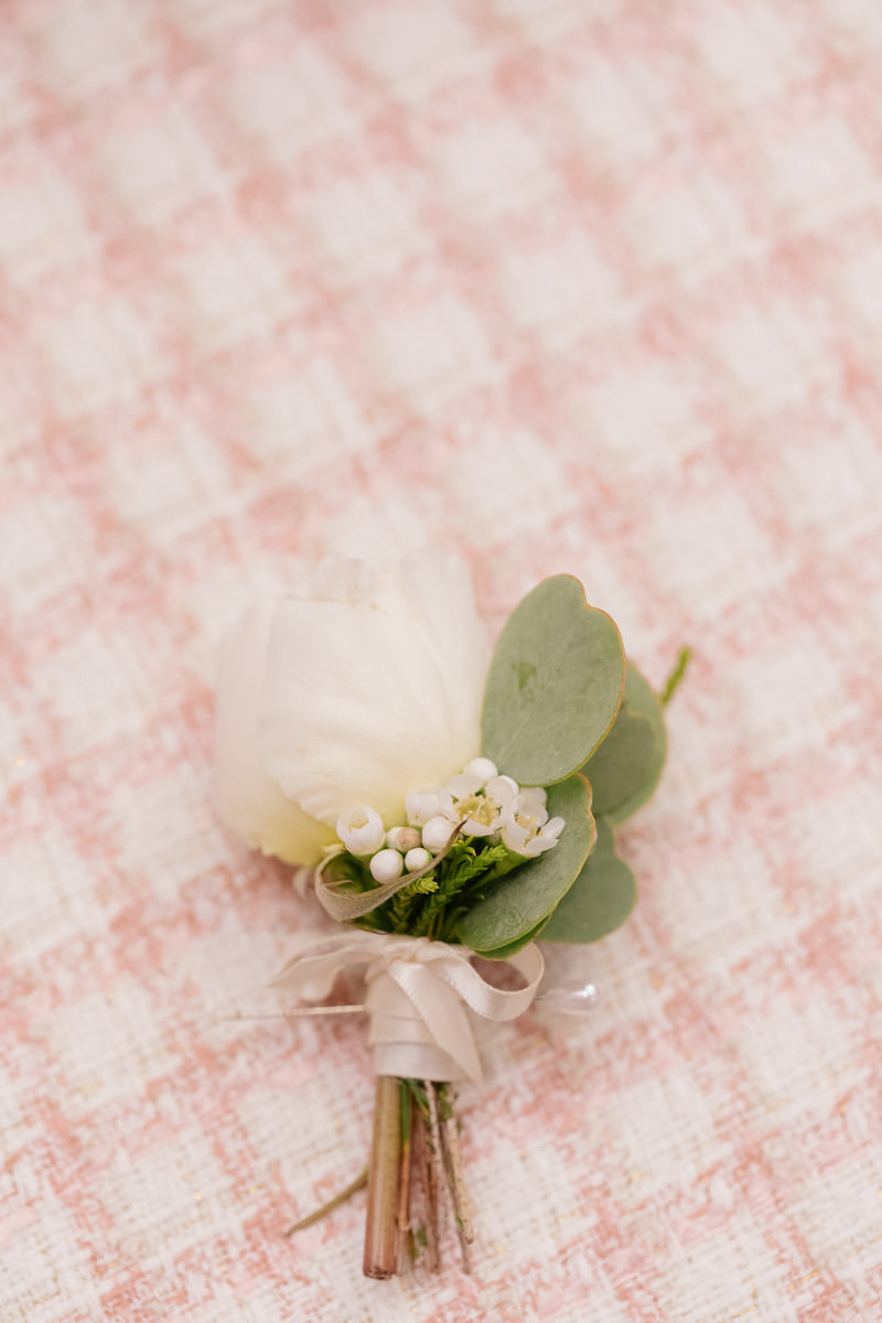 White, green and pink groom's boutonniere designed by Eddie Zaratsian