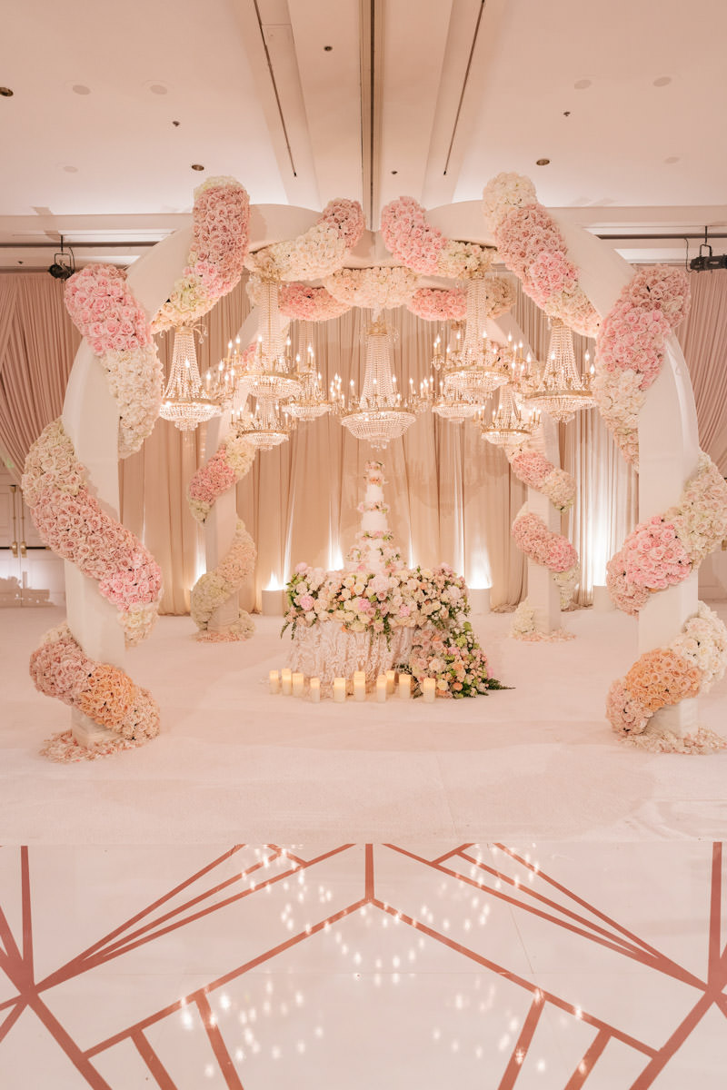 Spectacular pink, cream and copper wedding cake display and sweetheart table florals designed by Eddie Zaratsian, photo by Kris Kan