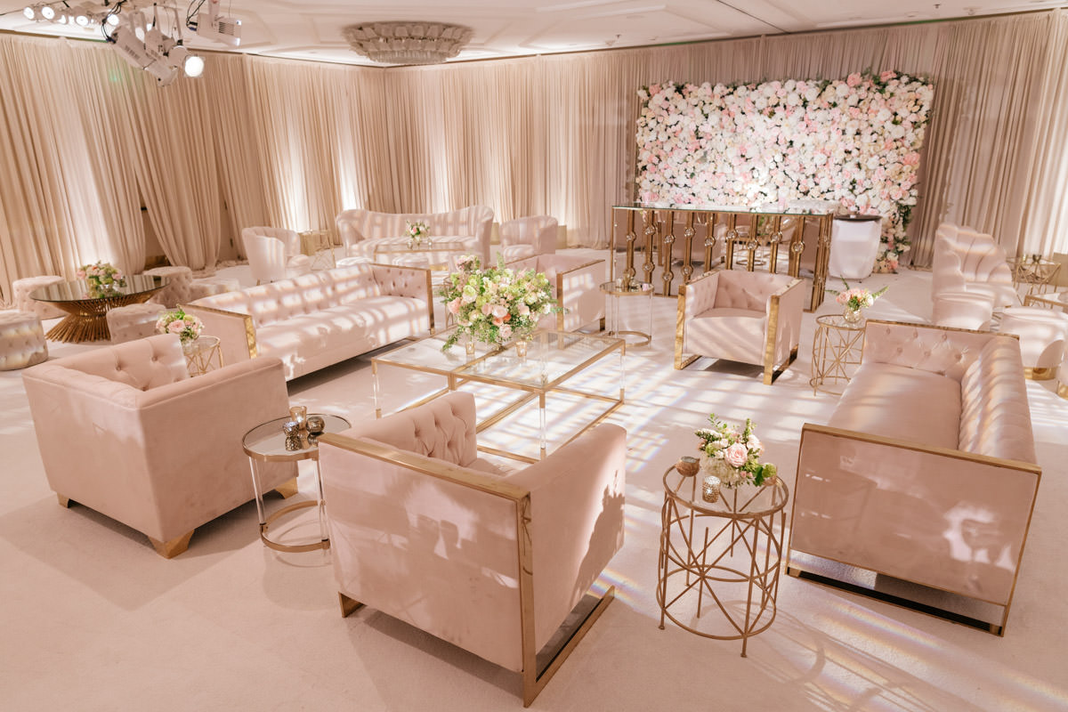 Modern pink, cream and copper wedding reception lounge area designed by Eddie Zaratsian, photo by Kris Kan