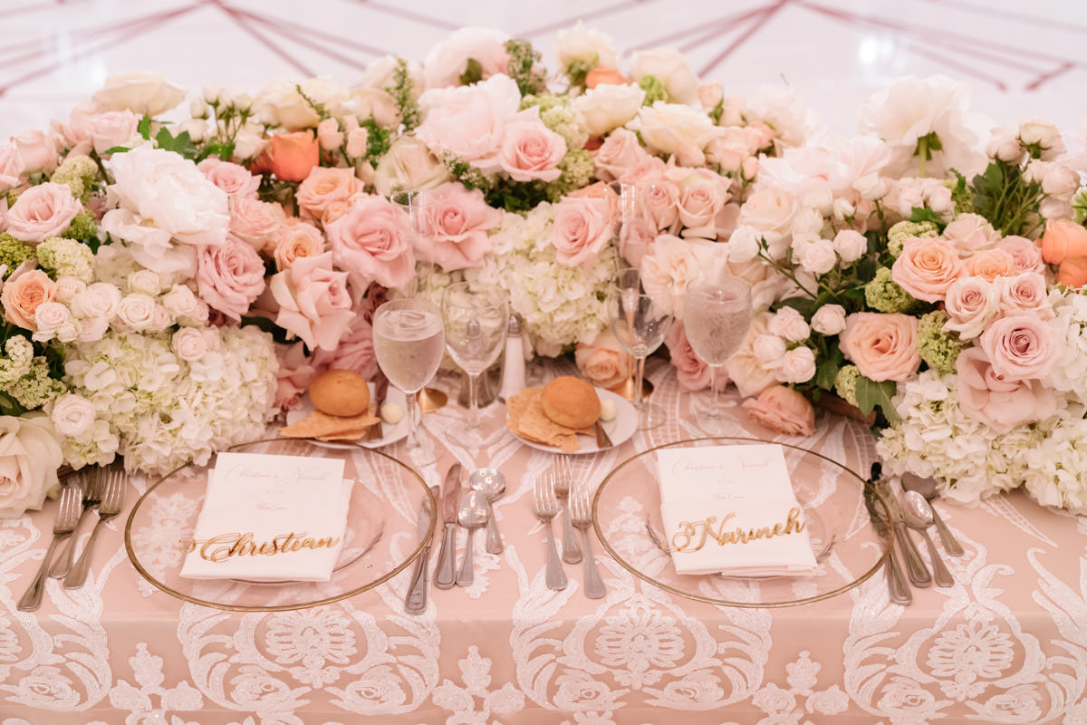 Incredible pink, cream and copper wedding table settings and florals designed by Eddie Zaratsian, photo by Kris Kan