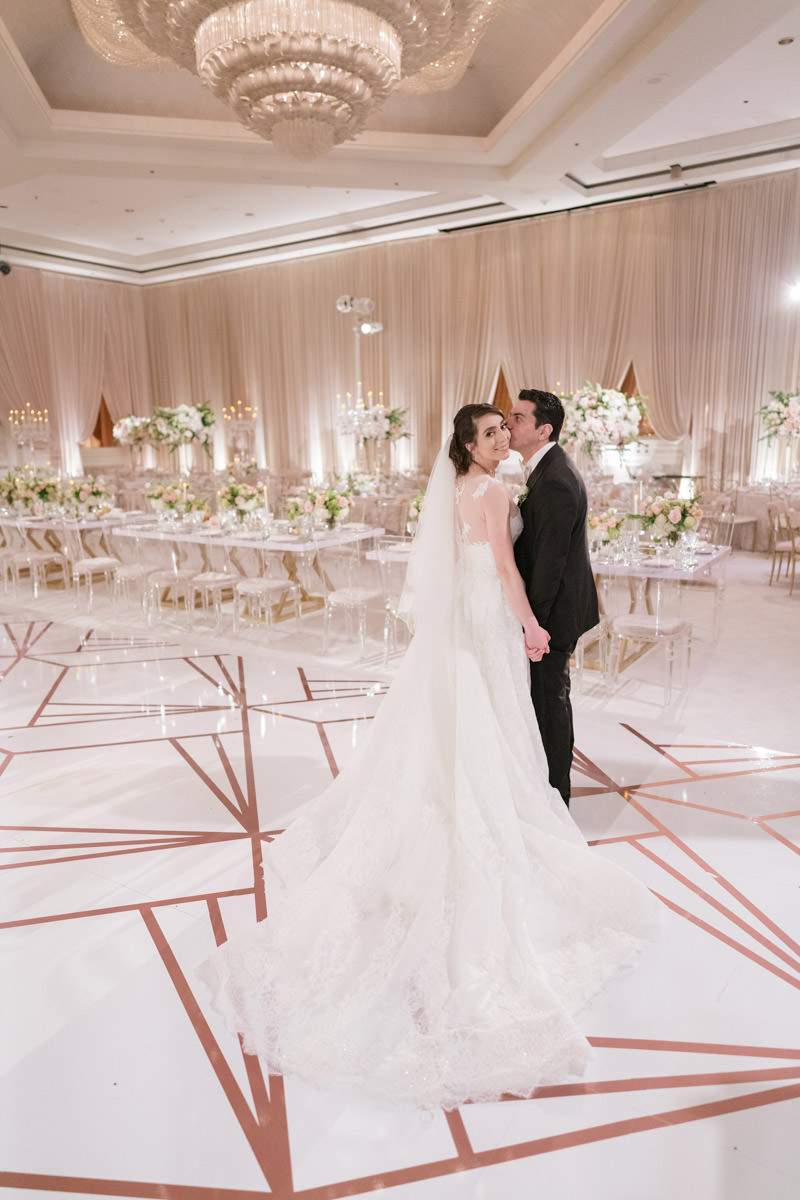 Bride and groom in their modern pink, cream and copper wedding reception - designed by Eddie Zaratsian, photo by Kris Kan