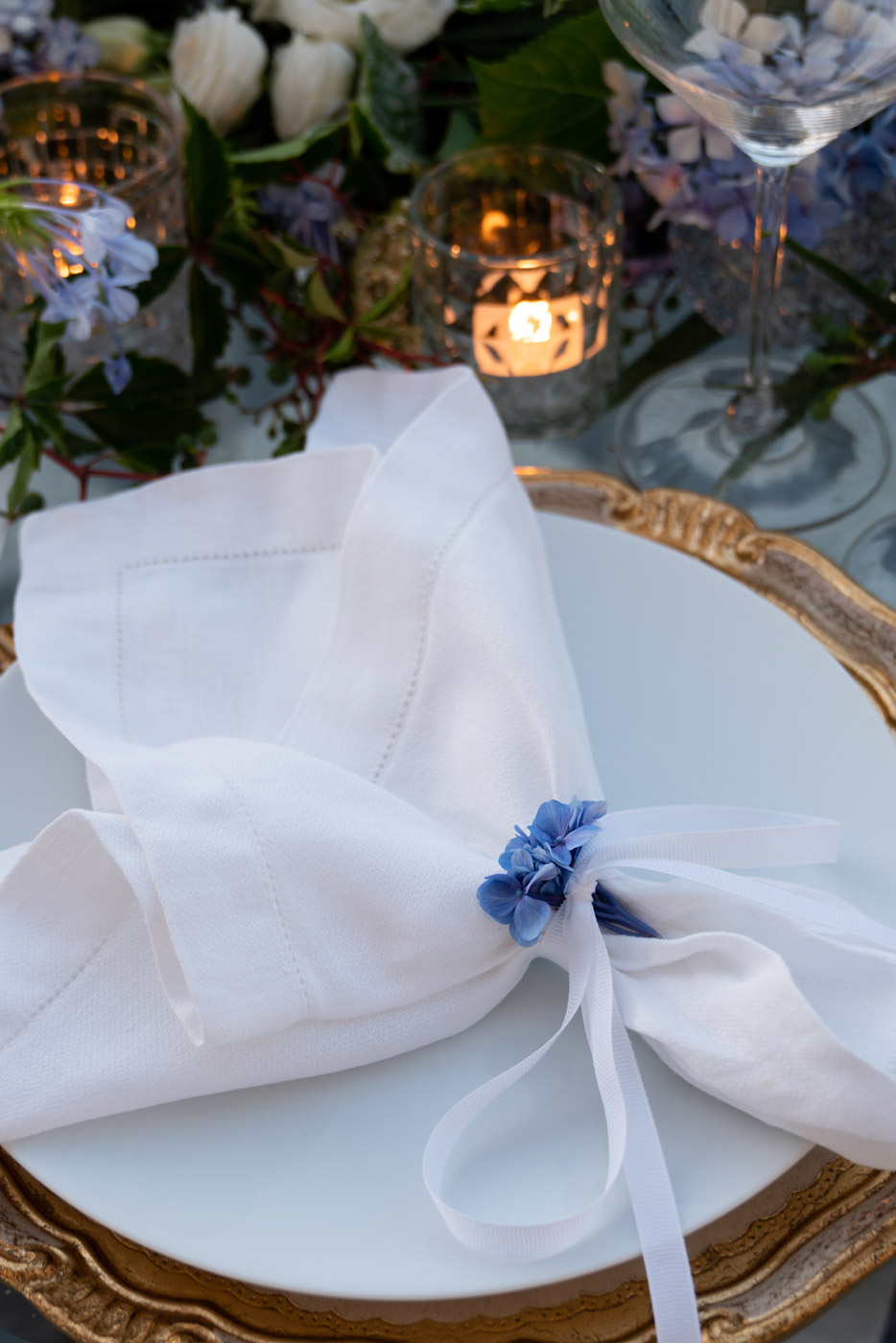 Wedding table setting floral napkin detail designed by Eddie Zaratsian at Villa Astor, Sorrento, Italy - photo by Adagion Studio
