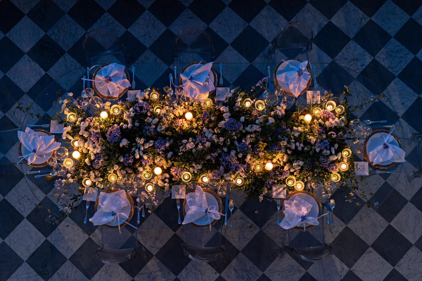 Candlelit wedding tablescape designed by Eddie Zaratsian at Villa Astor, Sorrento, Italy - photo by Adagion Studio
