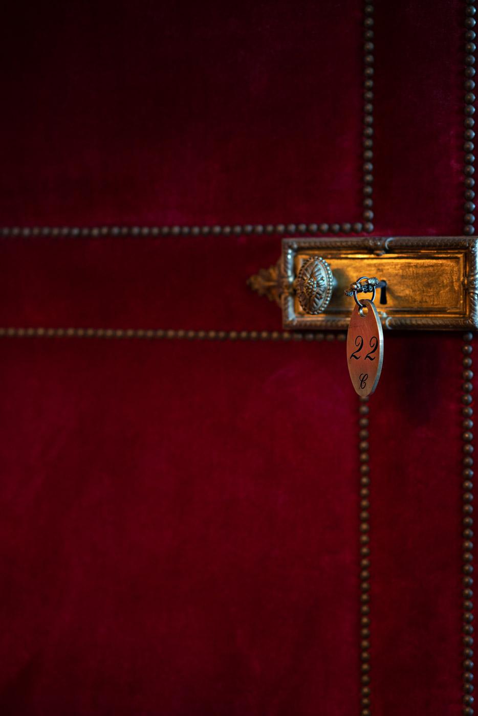 Red velvet door at Villa Astor, Sorrento, Italy - photo by Adagion Studio