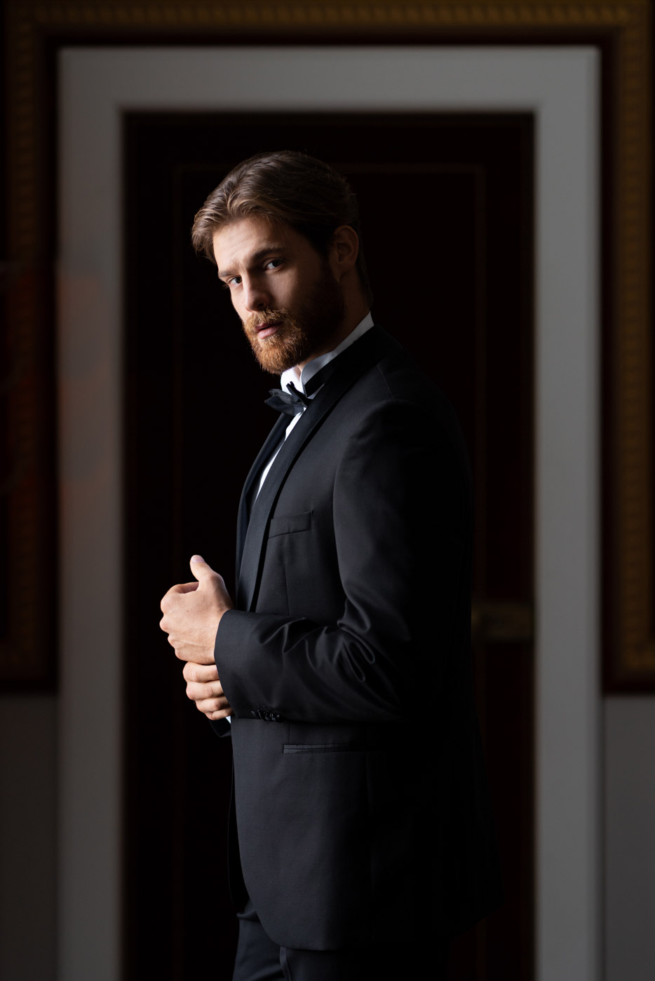 Stylish groom in a black tux at Villa Astor, Sorrento, Italy - photo by Adagion Studio