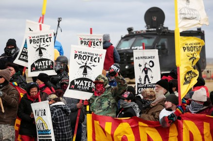Dakota Access Pipeline protesters square off against police near the Standing Rock Reservation and the pipeline route outside the little town of Saint Anthony, North Dakota. Photo: Terray Sylvester/Reuters