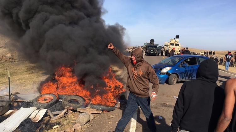 Protesters confront soldiers and law enforcement officers assembled Thursday to force Dakota Access pipeline opponents off private land. (Mike McCleary / Bismarck Tribune)