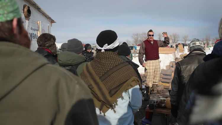 Military veterans are briefed on camps rules and their mission at Oceti Sakowin Camp on the edge of the Standing Rock Sioux Reservation on Saturday outside Cannon Ball, N.D. (Scott Olson / Getty Images via LA Times)