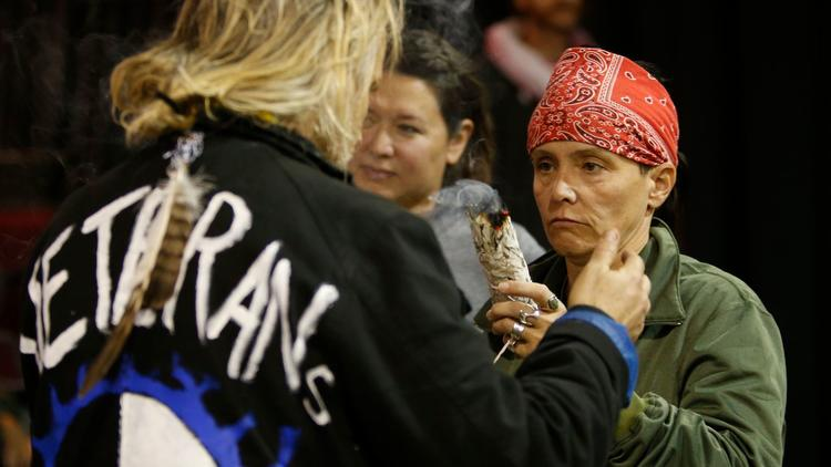 Tribal members conduct a cleansing ceremony for the veterans who traveled to North Dakota to oppose the Dakota Access oil pipeline. (Mark Boster / Los Angeles Times)