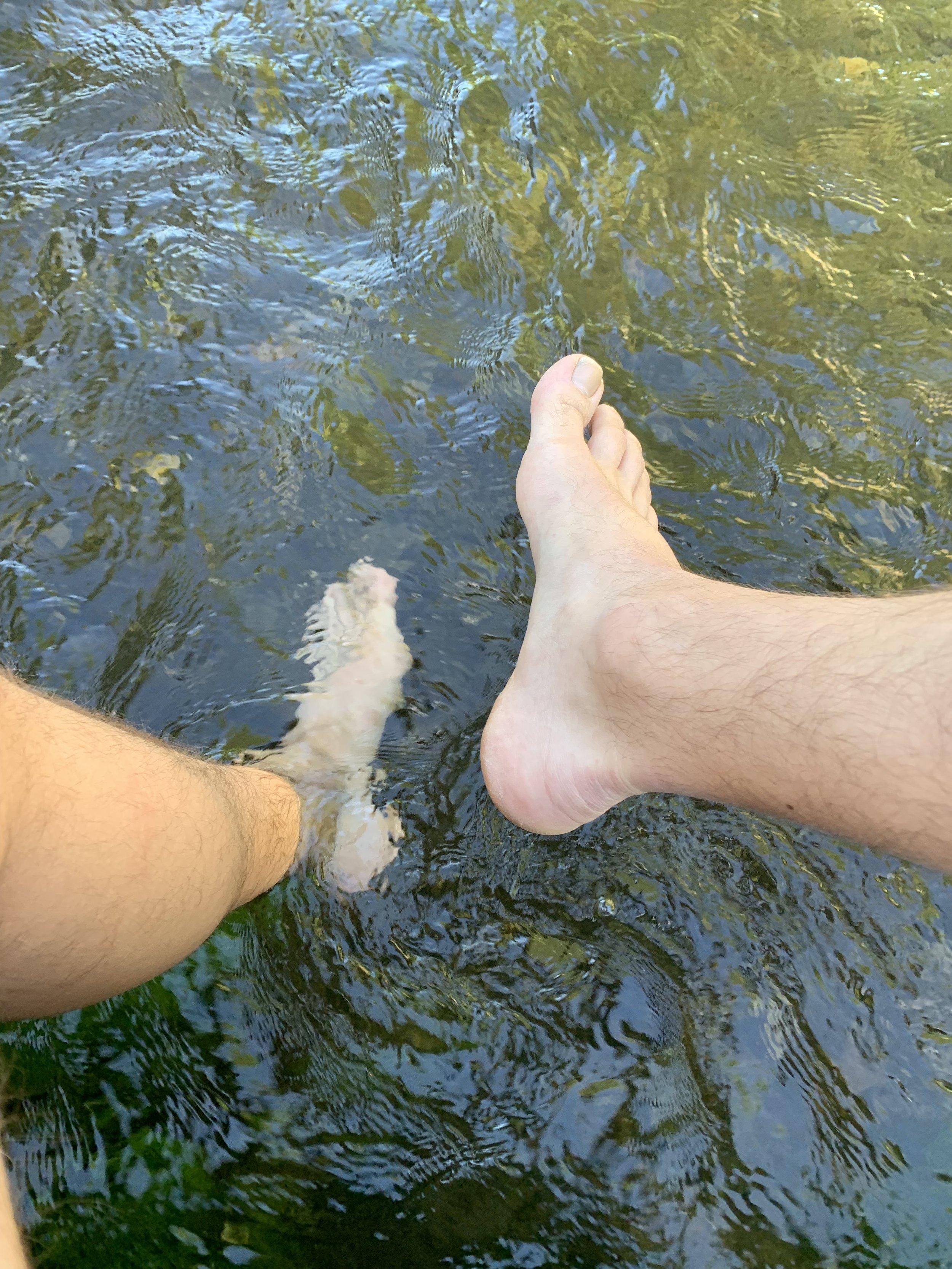 Soaking my feet in the ice cold river at Ribadiso Da Baixo