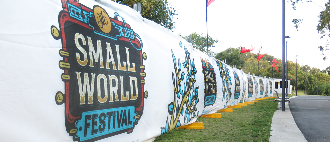 SCRIMWORKS_EXTERIOR_BANNER_MESH_SHADE_CLOTH_PRINTED_CONSTRUCTION_EVENTS_SIGNAGE_FENCING_SMALL_WORLD_FESTIVAL_1.jpg