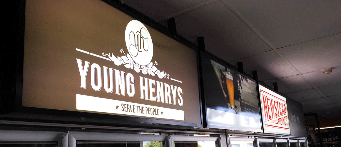 SCRIMWORKS_EXTERIOR_ACRYLIC_PERSPEX_SIGNAGE_BANNER_MESH_SHADE_CLOTH_PRINTED_CONSTRUCTION_EVENTS_SIGNAGE_FENCING_LIGHT_BOX_YOUNG_HENRYS.png