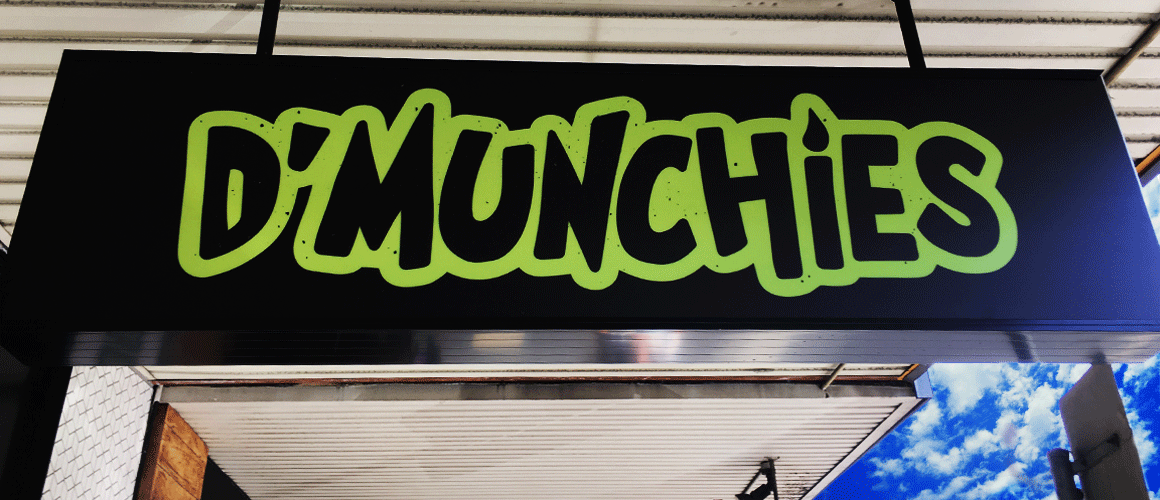 SCRIMWORKS_EXTERIOR_ACRYLIC_PERSPEX_SIGNAGE_BANNER_MESH_SHADE_CLOTH_PRINTED_CONSTRUCTION_EVENTS_SIGNAGE_FENCING_LIGHT_BOX_DMUNCHIES_1.png