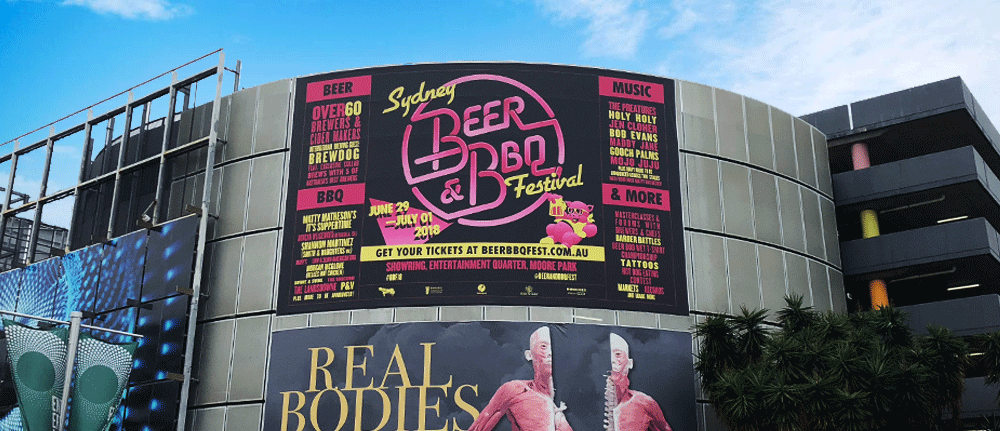 SCRIMWORKS_EXTERIOR_PREMIUM_BANNER_MESH_SHADE_CLOTH_PRINTED_CONSTRUCTION_EVENTS_SIGNAGE_FENCING_HOARDING_JUMP_FORM_BILLBOARD_CATTLEYARD_BEERBBQFEST_GROOVIN_THE_MOO_FESTIVAL_EQ_FOX_STUDIONS_MOORE_PARK.png