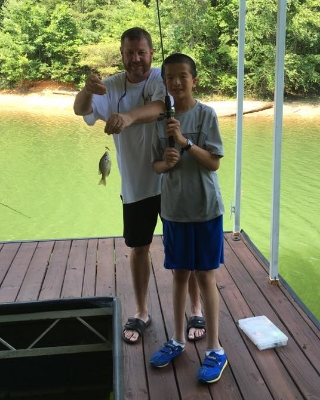 Meet Mr. Resilient, an 11-year-old boy who just caught his first fish with his host dad! See more photos from his host family by clicking on his picture.