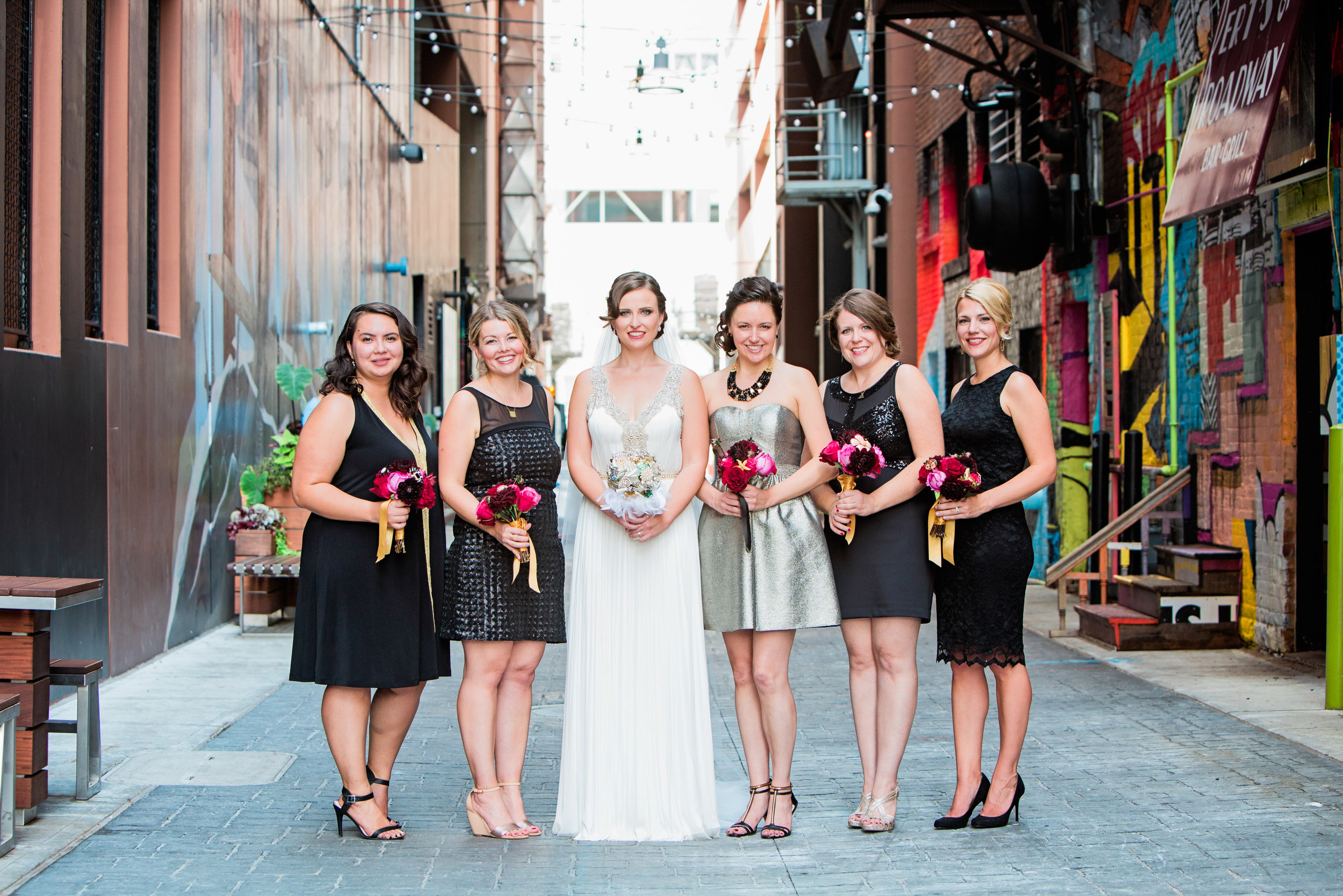 Katie in the Alley with Bridesmaids.jpg
