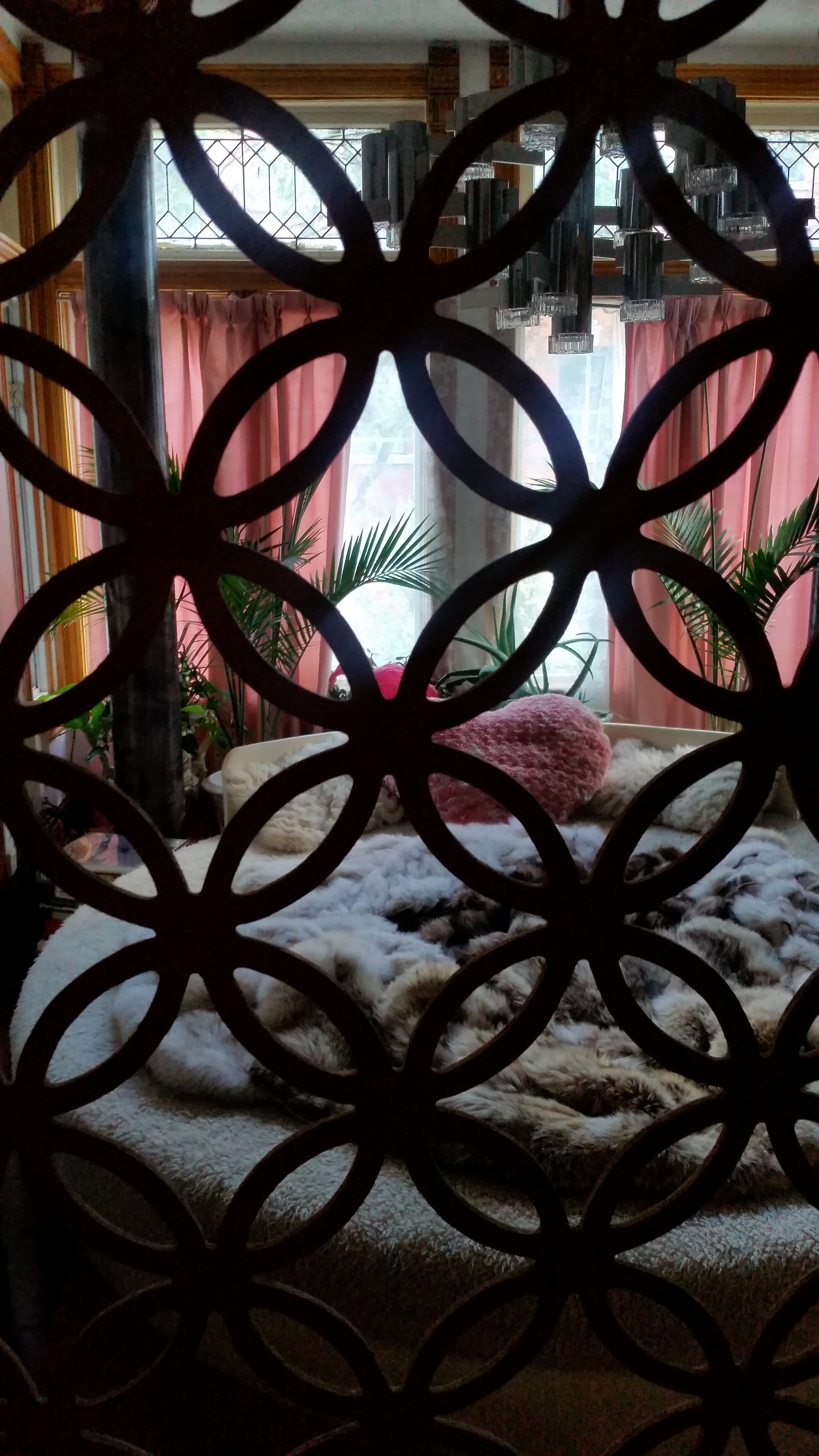 Looking through the lattice into the main floor bedroom.