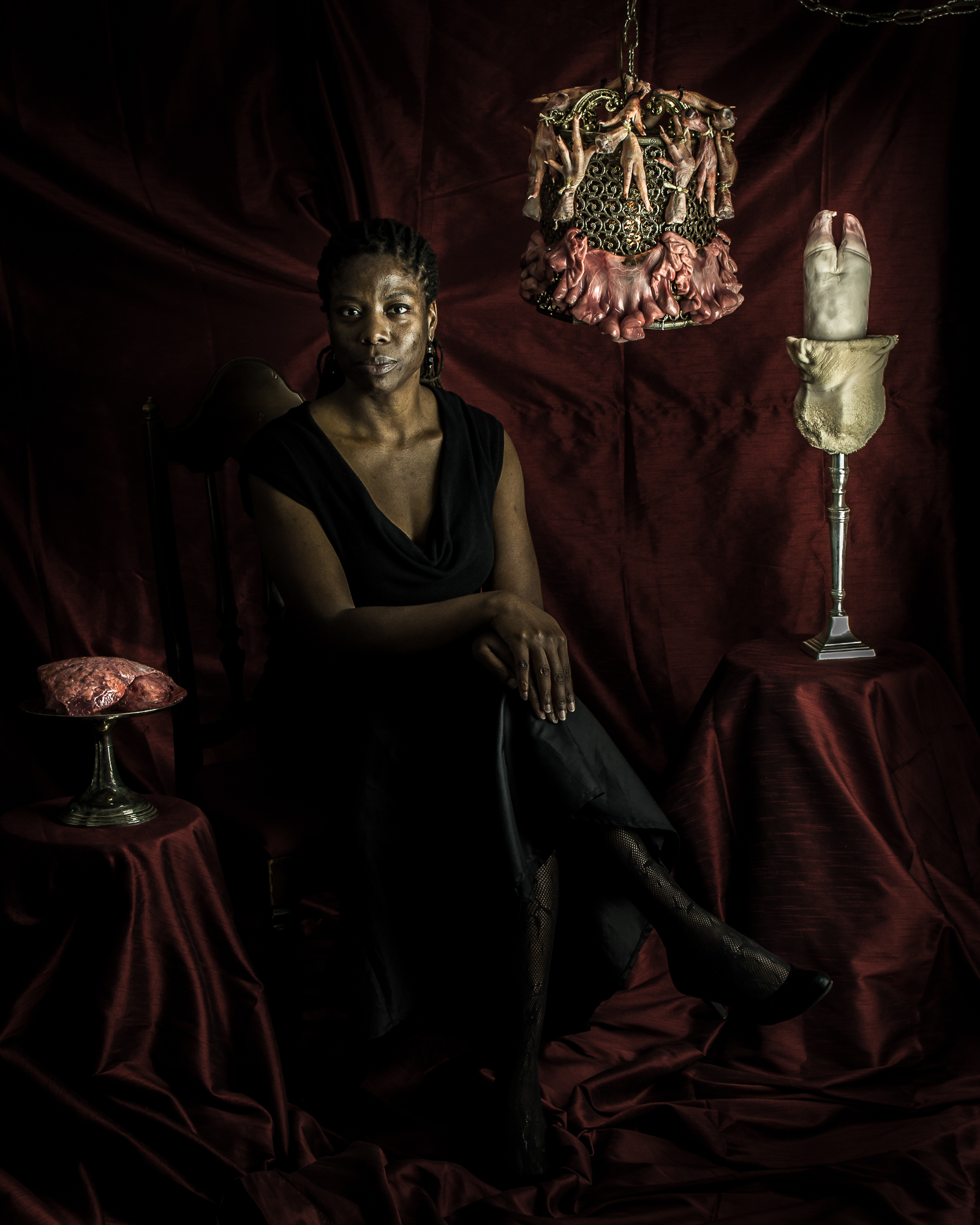 Another shot from our shoot. Me posing with cow lung, meat chandelier, and cow-foot candelabra bound in goat stomach.