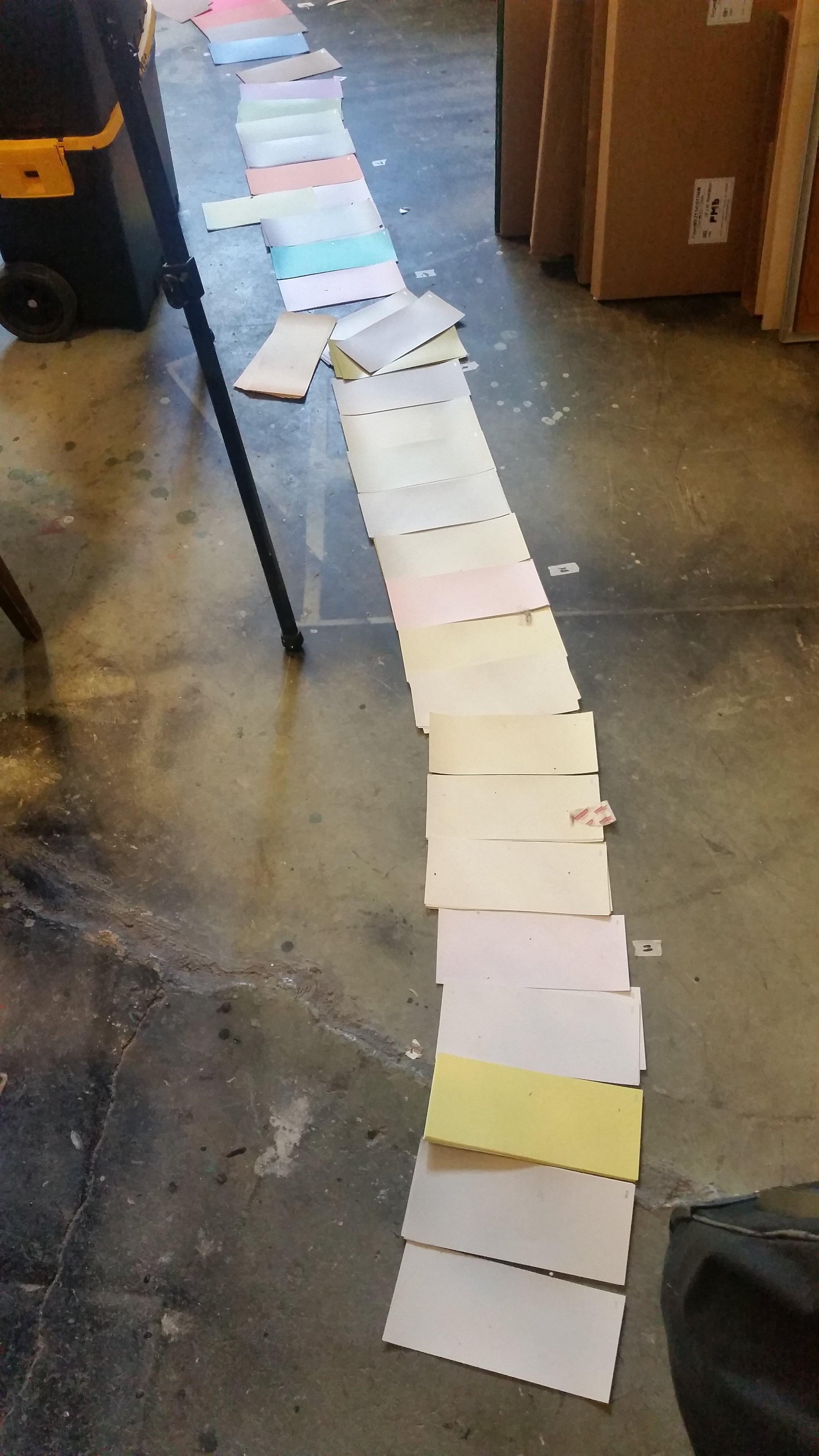 Paint chips on the studio floor.