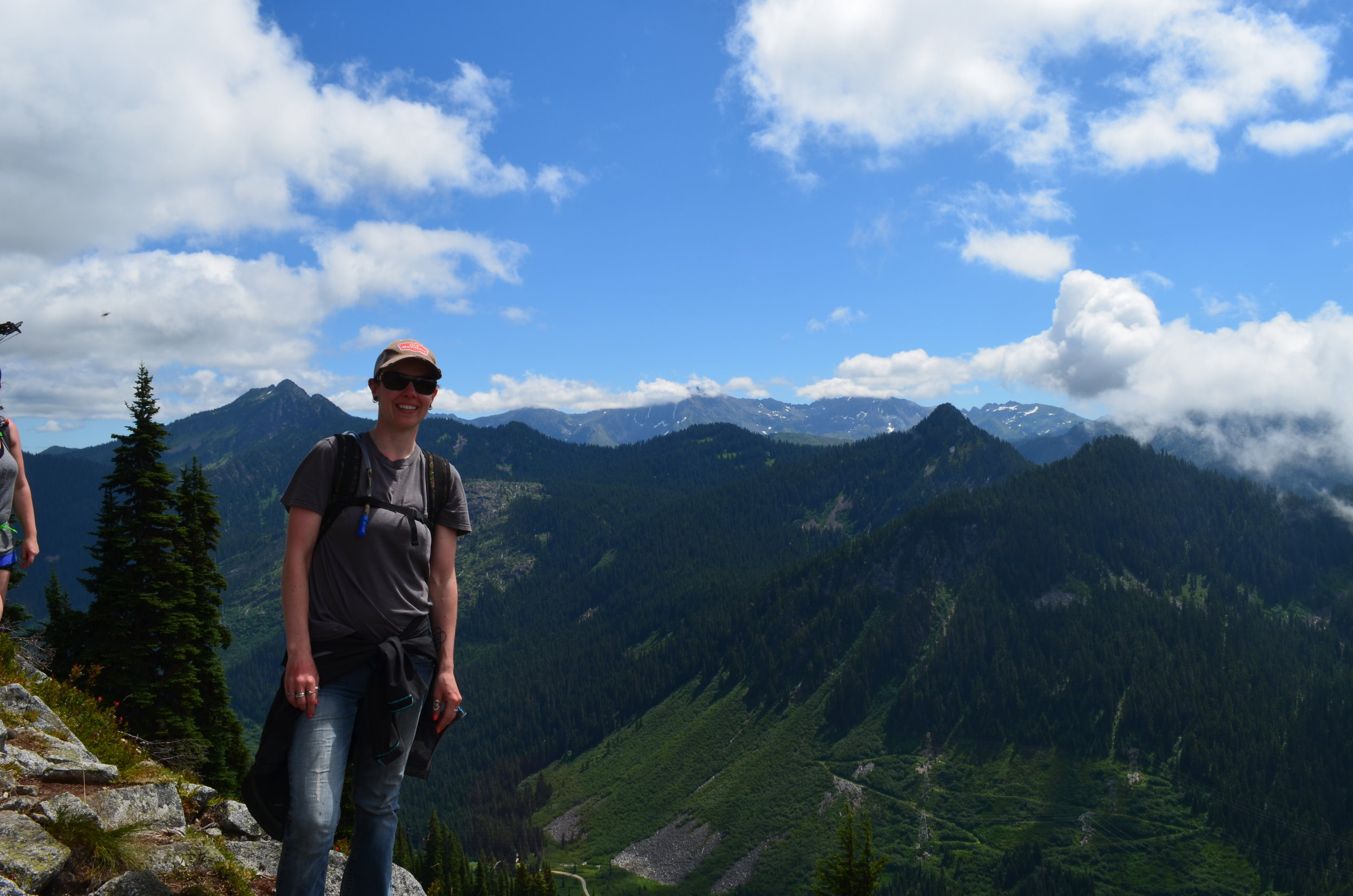 """Laura Morrison on top of the world in Stevens Pass Washington during the """"Northwest Mountain Challenge – Archery Shoot""""."""