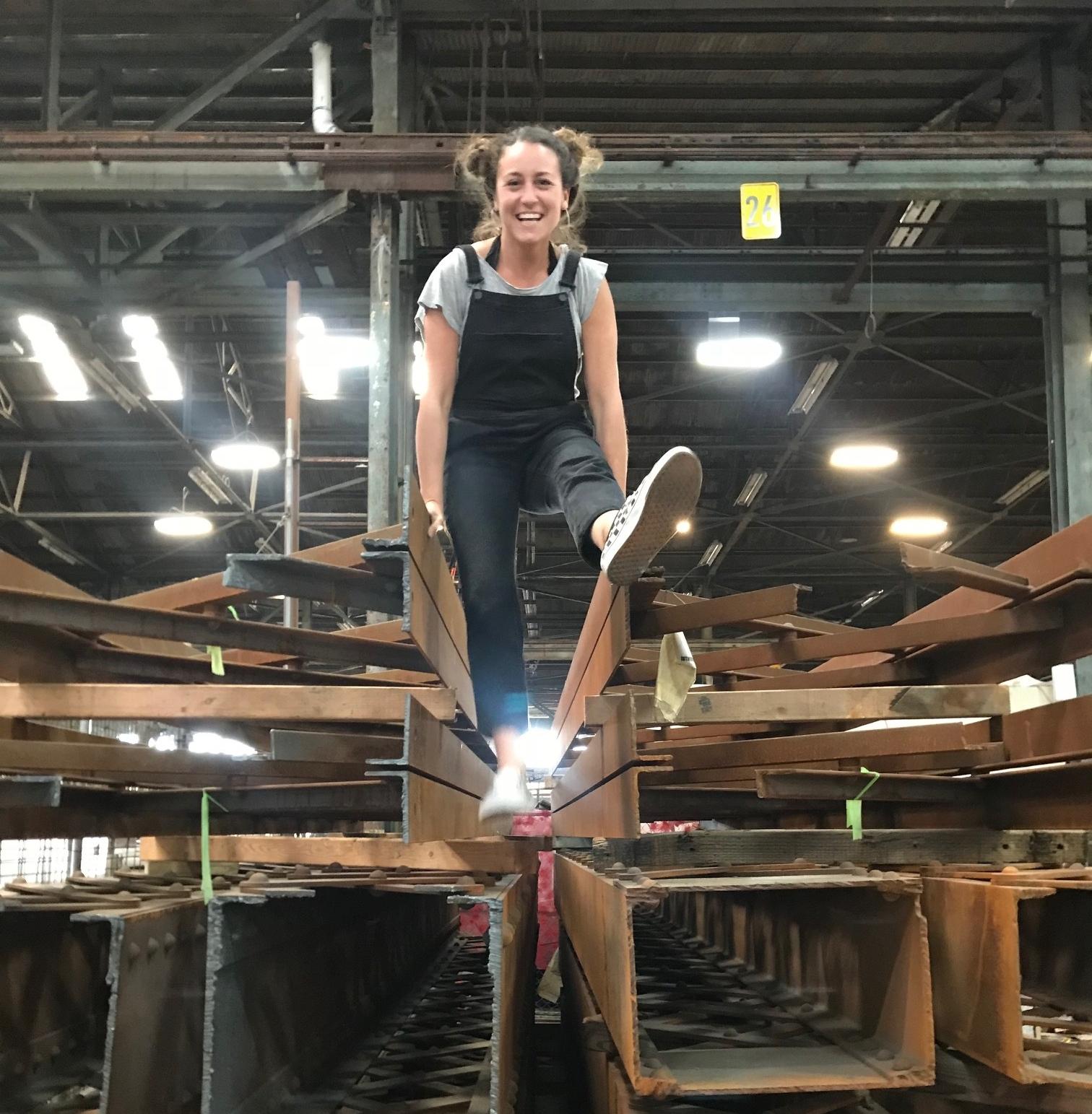 Shannon on top of 49,000 lbs of steel, awarded to artist Katy Boynton from the  Bay Bridge Steel Program