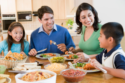 Family servings and relaxed conversation can be very helpful in taking the pressure off mealtimes - but how do you start?