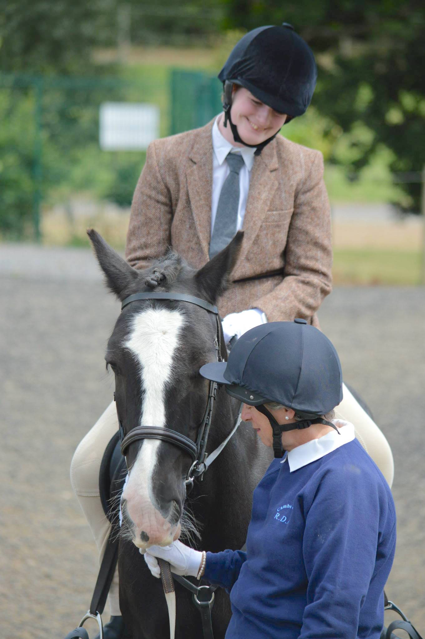 Rebecca riding Jacko with volunteer, Kathryn, at the RDA Champs 2015