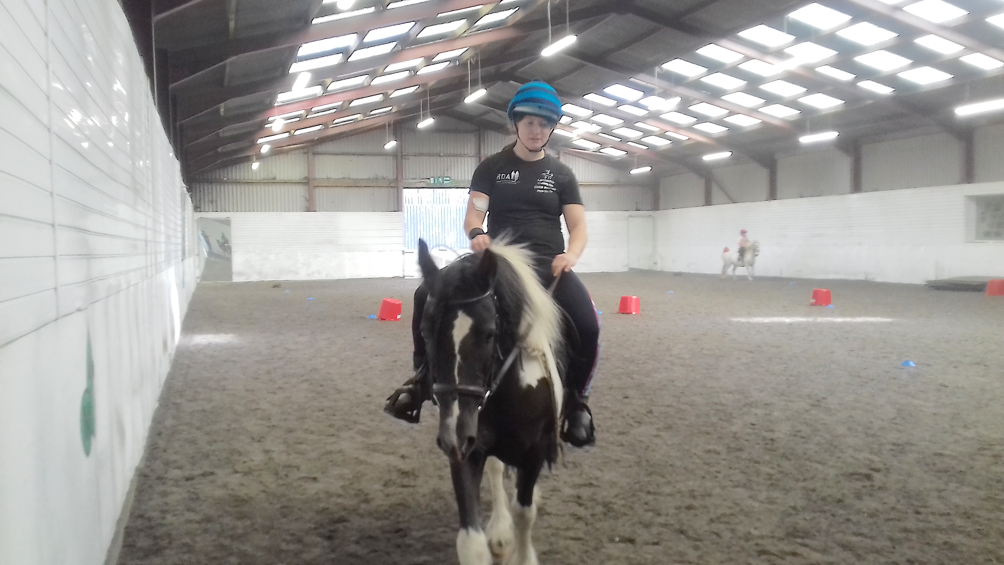 Attempting to sit straight and use normal reins, with very limited success