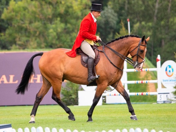 """Bicester-based Irishman Rory Gilsenan took the spoils in the Charles Owen Supreme Working Hunter Championship, riding Atlantic Slim.   At the tail end of last year, Rory was diagnosed with an aggressive brain tumour, and though his treatment is ongoing, he's determined not to let it stop him from enjoying his craft.  """"The horse loves the crowd, and he can gallop real well,"""" said Rory. """"It's the most incredible ring to ride around, it really is – we obviously watch it on telly a lot, and for us to get in there is just a slice of heaven."""""""