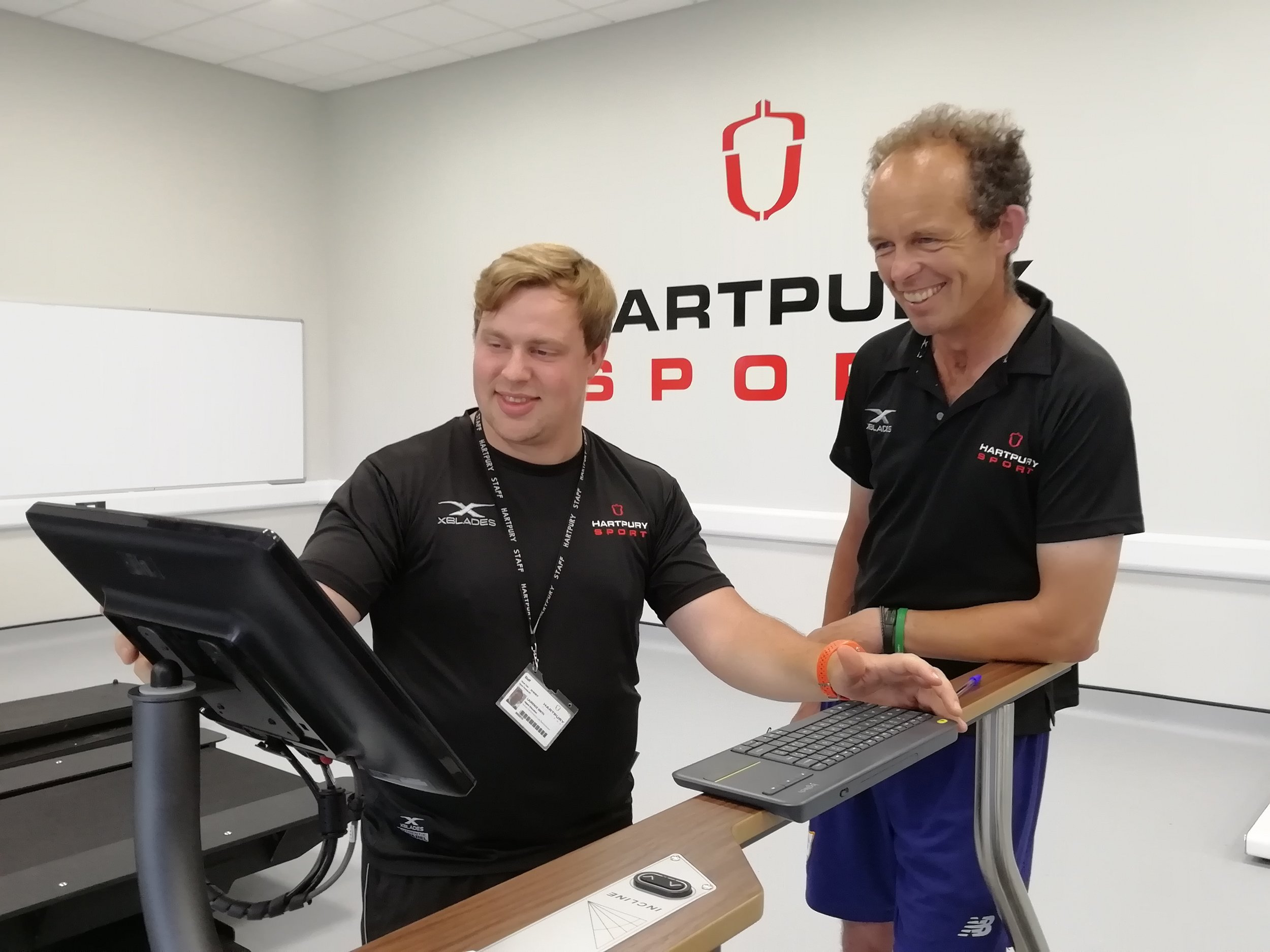 Jonty Evans analysing his training data with Laurence Smith from the Sports Science team at Hartpury.jpg