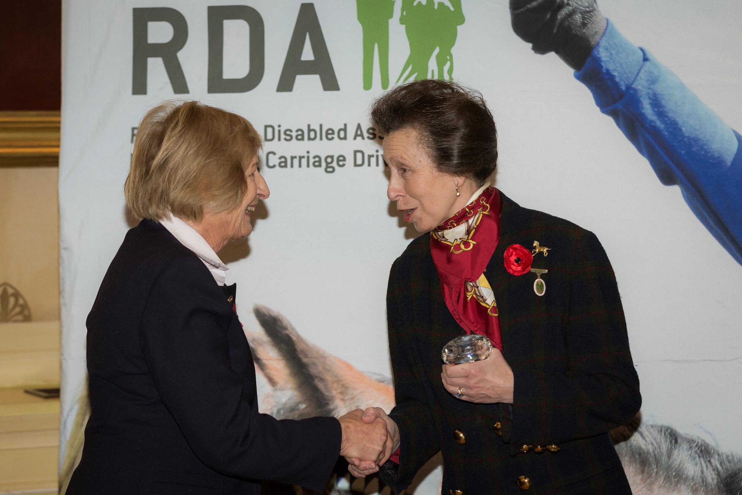 Gay Redman receiving an award for volunteering from HRH The Princess Royal