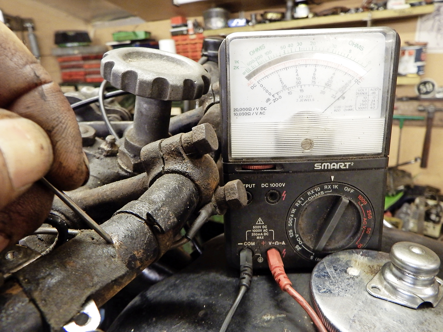 2.  While the meter's out, set to resistance (ohms) and check the handlebar is a good earth. Often they are not – especially when rubber-mounted. But we're OK here.