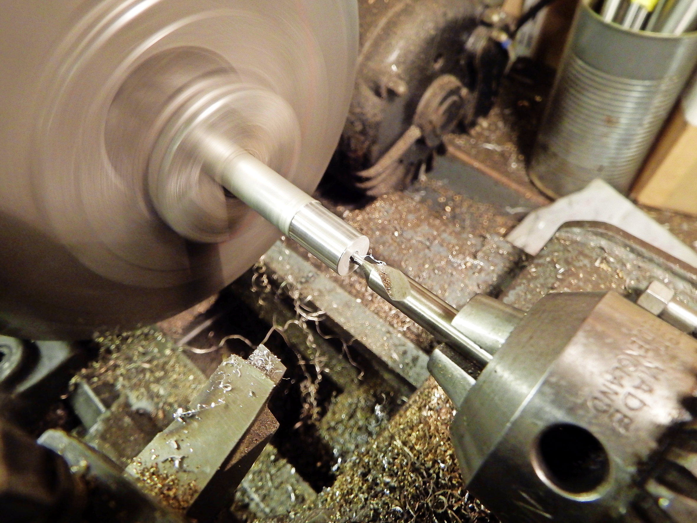 1.  If the thread is in aluminium, using the same material will accommodate expansion. First drill and tap the centre of the bar to match the stripped original thread.