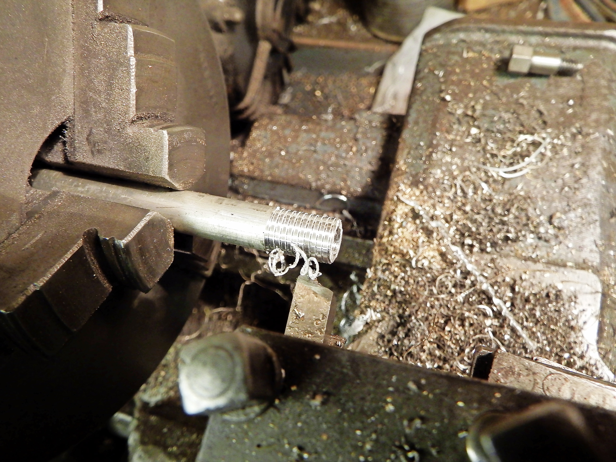 2.  Having tapped the stripped hole to a suitable oversize, you need to turn down the aluminium to an appropriate diameter and screw cut (or use a die) to thread the outside.
