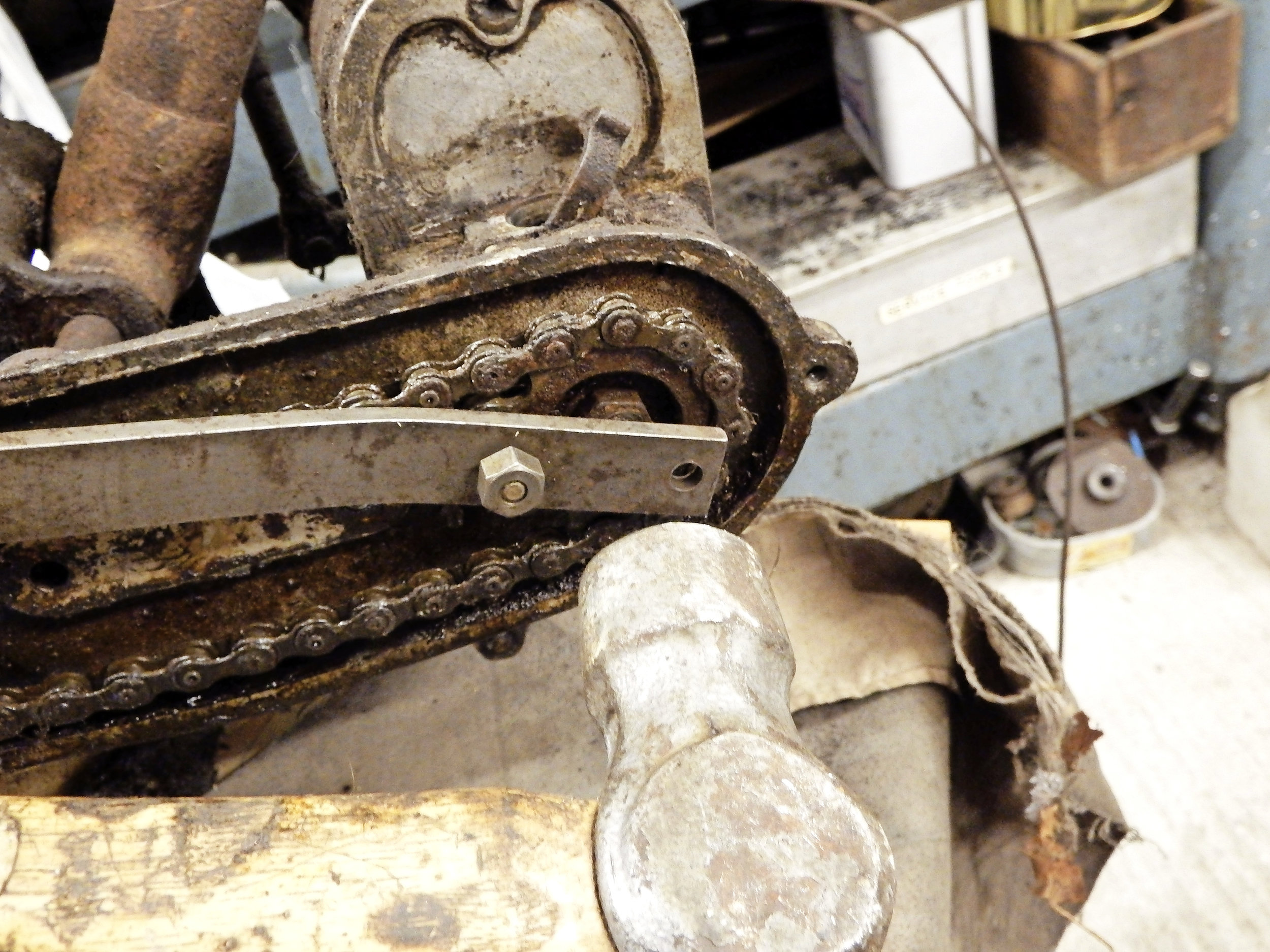 4.  If the sprocket is really stuck, don't use excess force on the lever; keep up the pressure and smartly strike the blade with a hammer where it crosses the pinion nut to spring it free.
